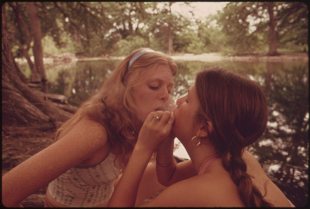 Two Girls Smoking Pot During an Outing in Cedar Woods near Leakey, Texas